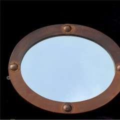 Arts and Crafts oval copper mirror.