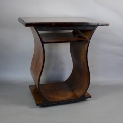 Art Deco walnut table on curved supports