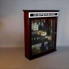 Dispensing cabinet in mahogany c1920 .