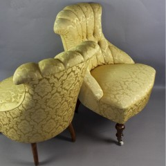 Pair of Victorian button backed armchairs in gold patterned fabric