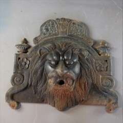 antique cast Iron Lions fountain head.