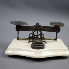 Ceramic and brass postal scales.