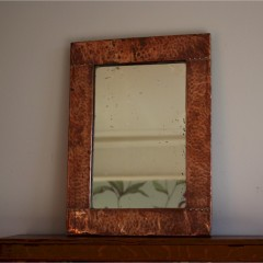 Simple arts and crafts copper framed mirror . c1900