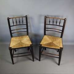 Sussex chairs a near pair by Morris & Co