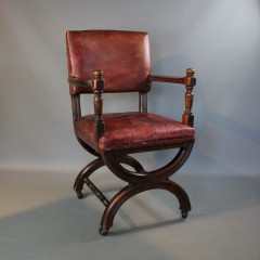Victorian X framed mahogany and leather chair