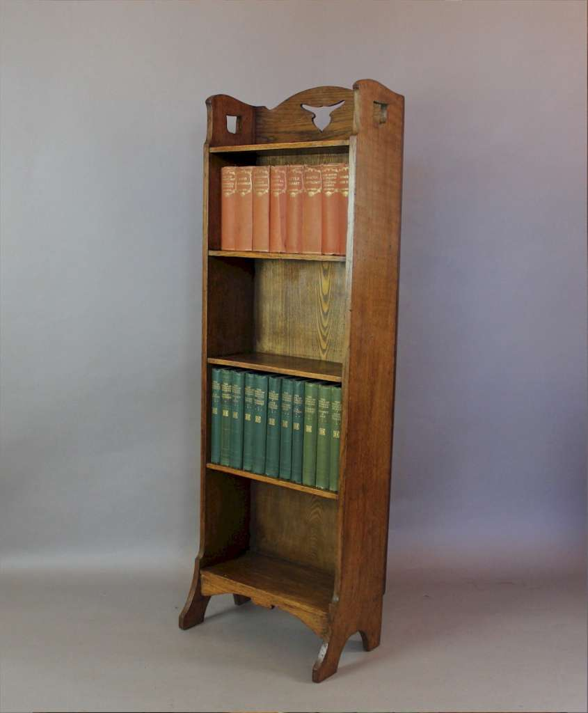 Arts and Crafts oak open bookcase with tulip shaped cut outs